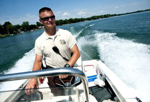 Deputy Driving A Boat on a Lake